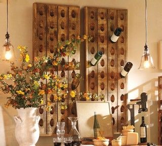 Wine Bottle Riddling Rack, these are used to store bottles at just the right angle in champagne cellars. I've seen both vintage & reproductions (like this one from pottery barn) all over the web. What a cool addition this would be, while displaying my interest in wine.