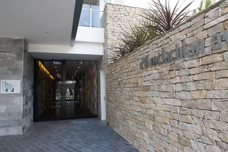 Dusky Dry Stone Wall cladding is made up of a mixture of split granite pieces.  #granitecladding #outdoorlife #cladding #sydneybuider #stonecladding #featurewall #outdoorenvirenment #cappingstone