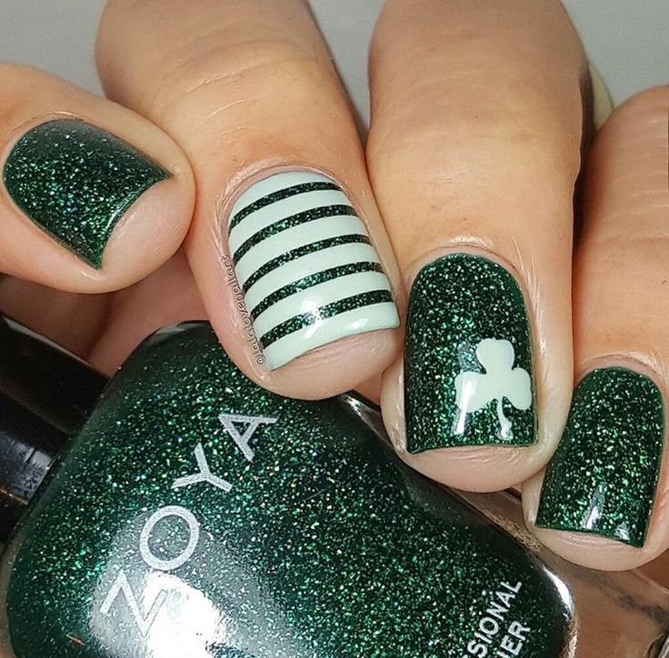Fabulous green and white St. Patrick's Day Shamrock manicure by @lalalovenailart using our Clover Nail Decals found at snailvinyls.com