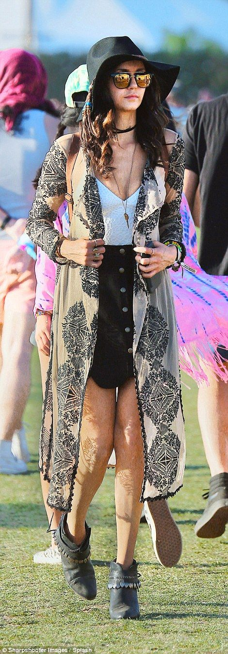 Hanging out: Nina Dobrev was seen in the fields of Coachella, looking suitably bohemian ch...