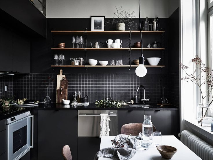 Studio apartment with dark kitchen and loft bed