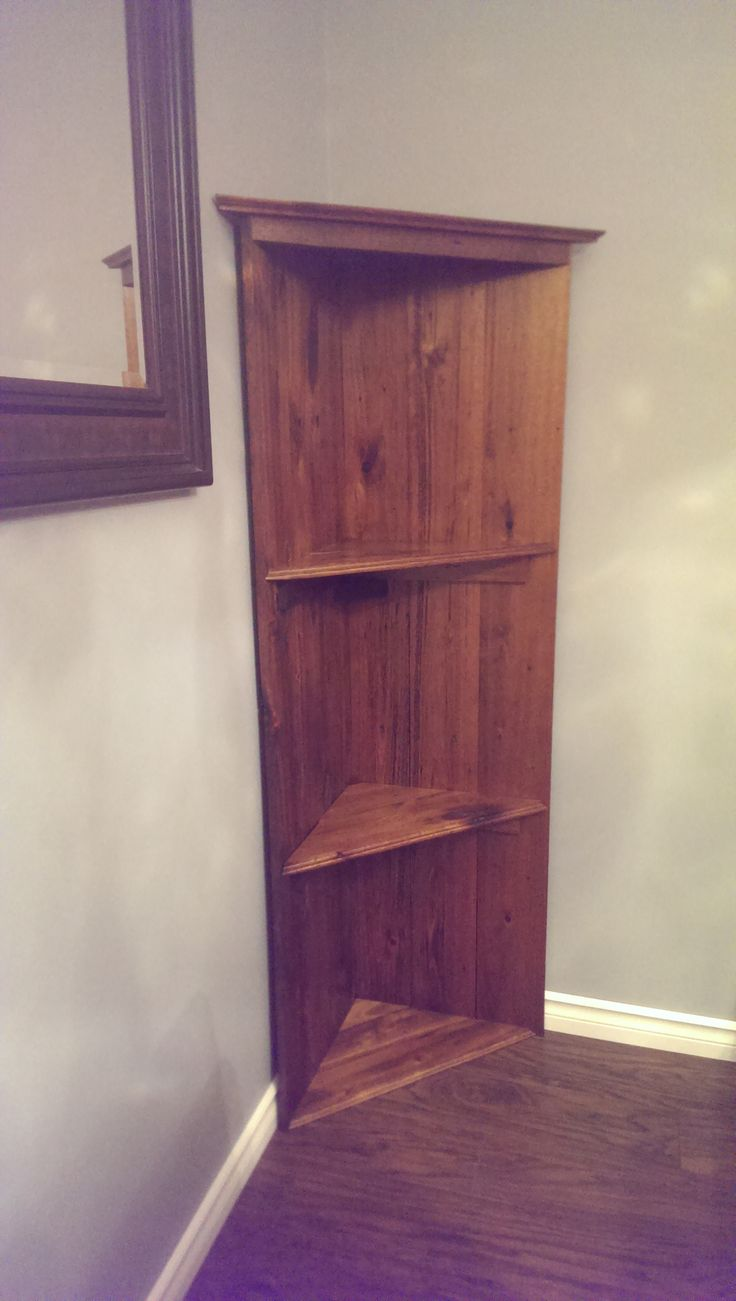 Completed DIY corner bookshelf from reclaimed red oak
