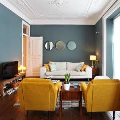 Apartamento Saldanha_Reabilitação Arquitectura + Design Interiores: Salas de estar ecléticas por Tiago Patricio Rodrigues, Arquitectura e Interiores
