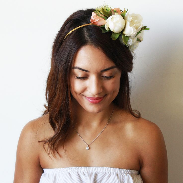 Our Lola Reversible Headband is what Aggie   Lola is all about. Beautiful flowers, versatility and fun. Made with beautiful light pink roses, white roses, peonies and carnations sat on a beautiful gold finished headband. Why not wear one side at your hens and the other at the races.