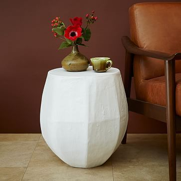 Papier Mache Drum Side Table  from west elm, this would maybe be a good DIY. Paper mache is... like kindergarten status.