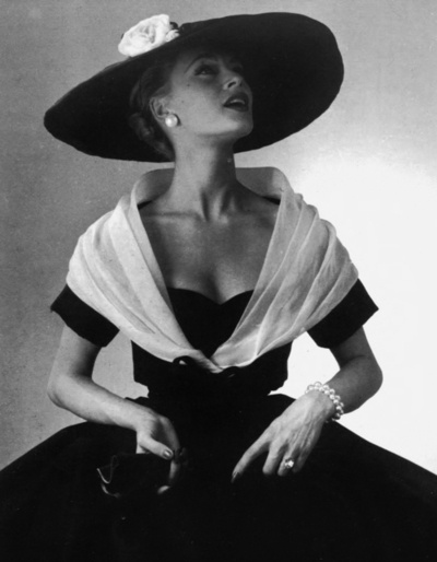 Christian Dior's black silk faille cocktail dress with white fichu, Spring 1955.
