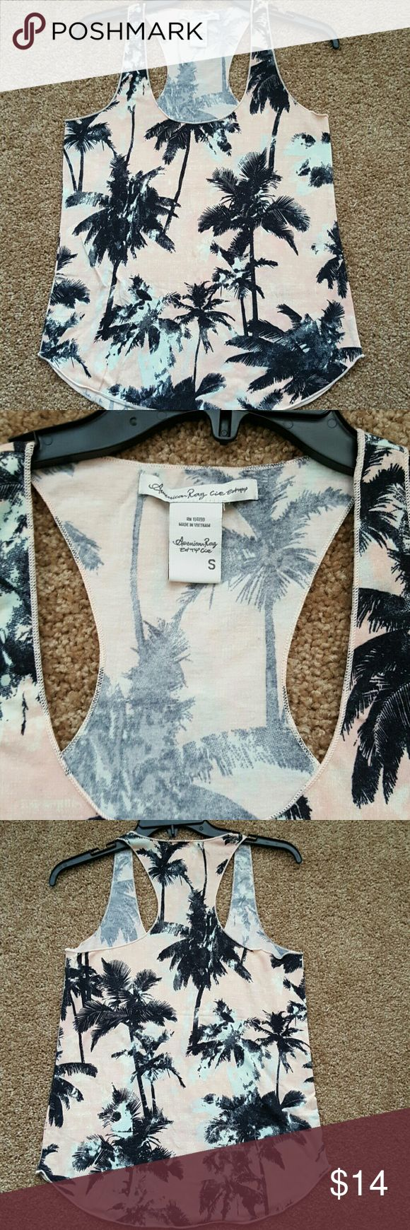 American Rag palm tree tank Small Small tank with black palm trees on white, blush pink, and sky blue background. New without tags. Never worn American Rag Tops