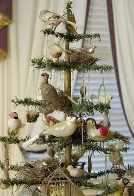 Feather Christmas tree full of vintage bird ornaments