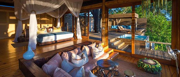 Enjoy game viewing from your plunge pool at honeymoon favourite Vumbura Plains.