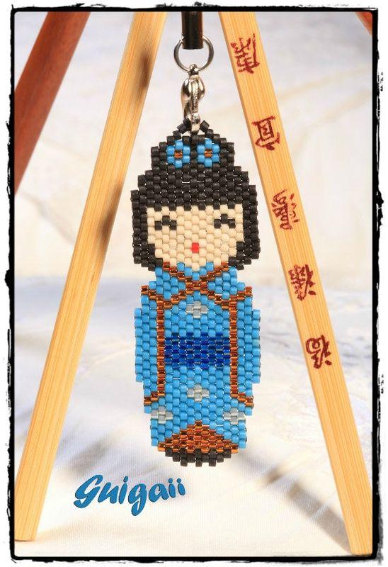 Kokeshi bleue S-framed