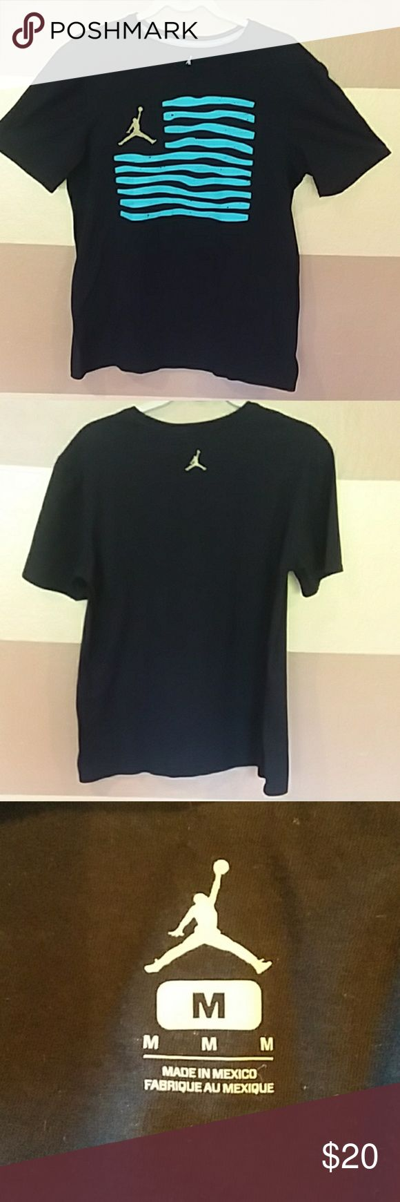 Michael Jordan T-shirt This is a like new T-shirt with nice Jordan design detail Color black with  gold Jordan emblem and teal striped across the chest. Best offer accepted Jordan Shirts Tees - Short Sleeve