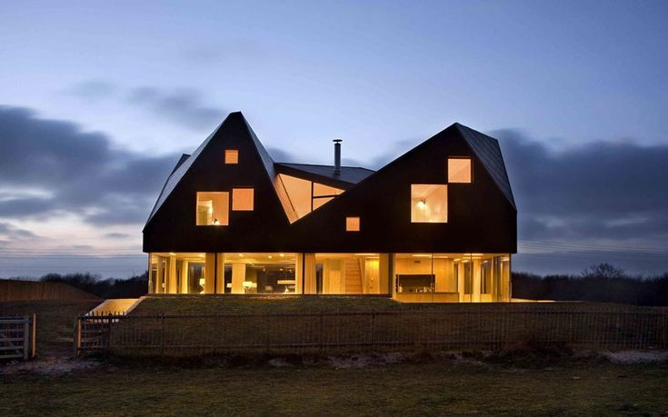 Dune House by Jarmund/Vigsnaes Architects and Mole Architects    With its angular roof sitting atop a glass lower floor, this house, the third in Alain de Botton's Living Architecture series, appears to float above the coastal Suffolk fields of its setting.
