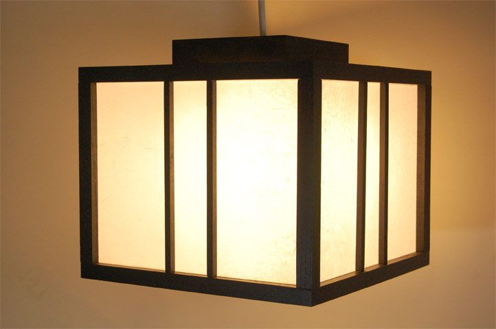 A lamp made using dark wood and shoji paper.