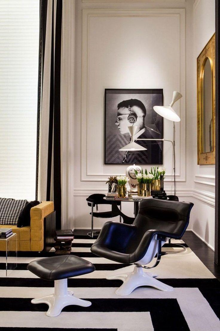 salon noir et blanc fauteuil avec repose pieds en cuir noir et mtal blanc