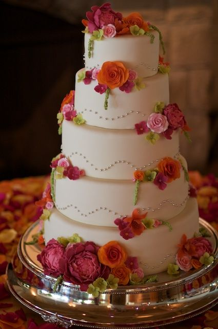 Love the pink and orange flowers on this cake