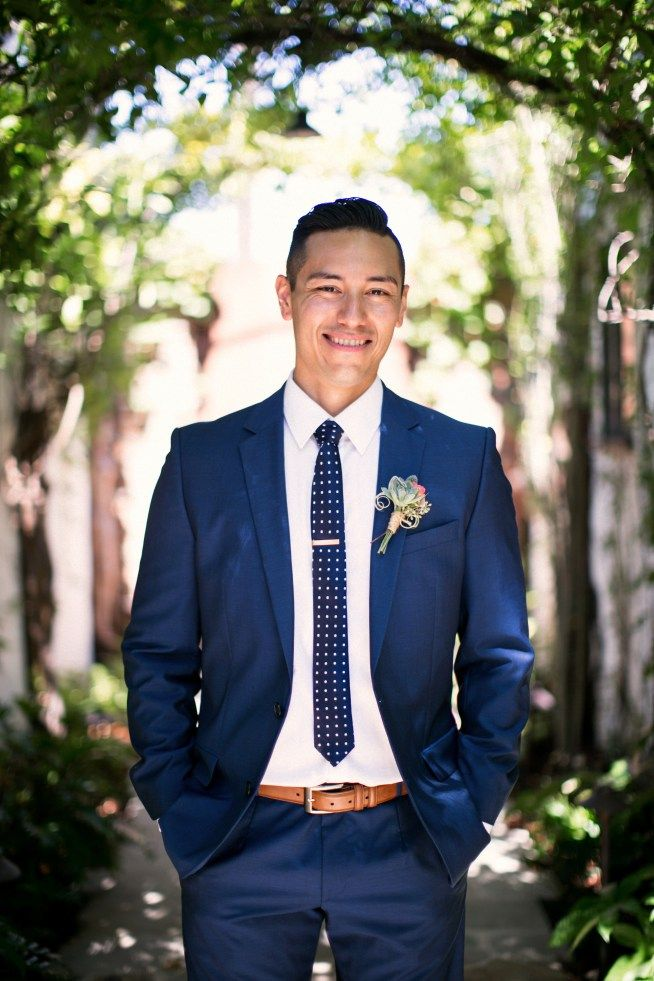 Groom in navy suit succulent boutonniere and polka dot for Blue suit shirt ideas