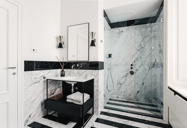 Located in a nice residential area in Milan, the apartment is part of an elegant and well designed 1920's complex.  #nomadearchitettura #design #interiors #interiordesign #italiandesign #italianstyle #luxury #milaninteriors #decor #marbles #bathroom #lightgrey #luxurylife #SimoneFuriosi