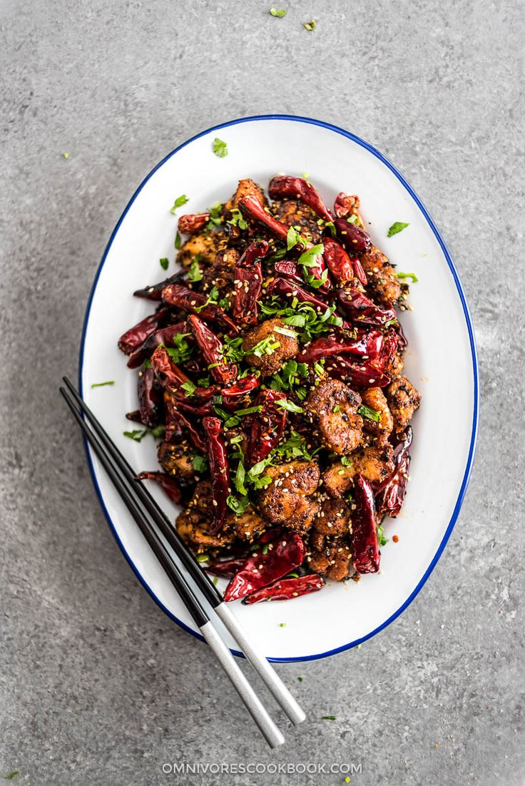Addictive Sichuan Mala Chicken (辣子鸡, La Zi Ji) - A plate of crispy chicken smothered in chili peppers, Sichuan peppercorns, and tons of aromatics.