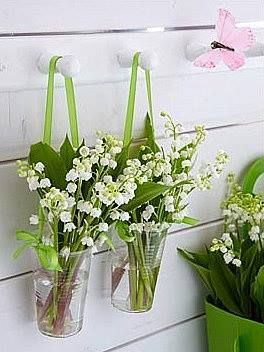 Clear solo cups with ribbon, adding some live pips from the over abundant lily of the valley