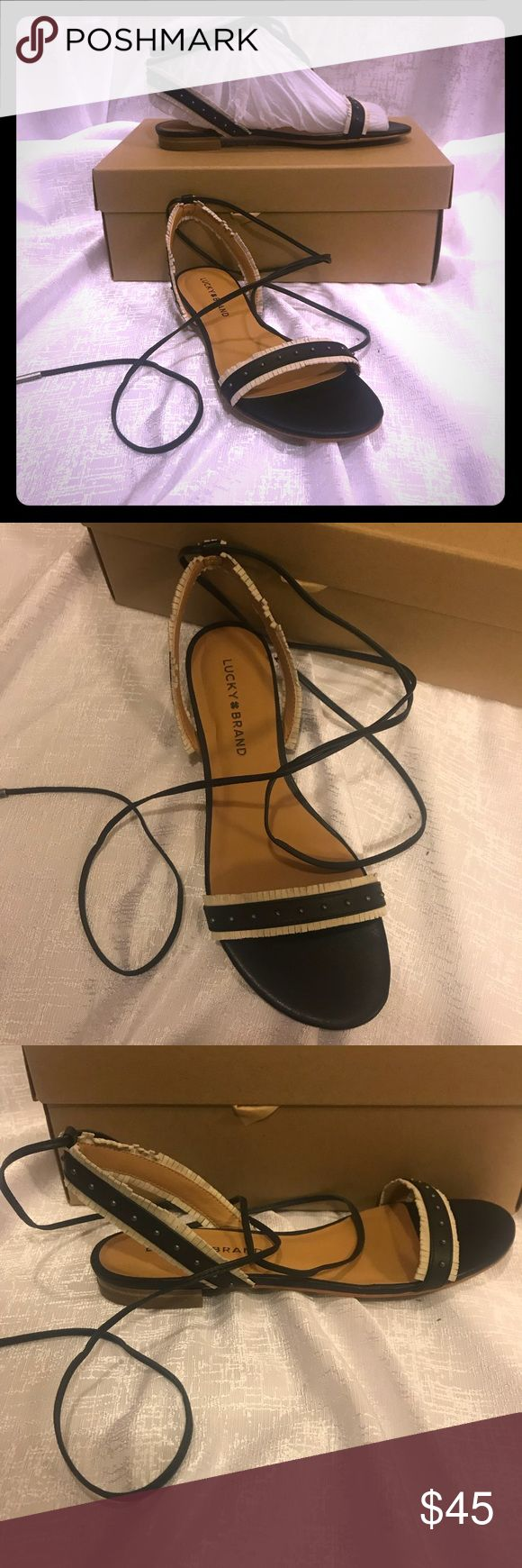 Lucky brand black/Ivori Sandal size 7 NBW Lucky brand black/Ivory  Sandal size 7 NBW with box Lucky Brand Shoes Sandals