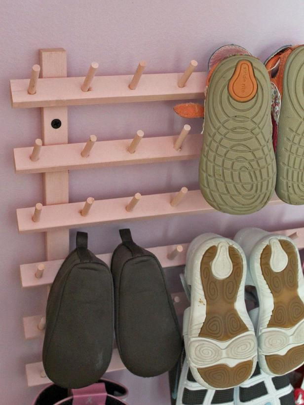 Wooden Baby Shoe Rack Amanda Hervey of A Lovely Place to Land turned an inexpensive wooden thread rack into a charming approach to display a baby's first shoe collection. Amanda prepared the thread rack for painting by first spraying it with primer to create a canvas for consistent, all-over color. The thread rack can either be displayed on a tabletop or dresser, or mounted on a wall after removing the legs.