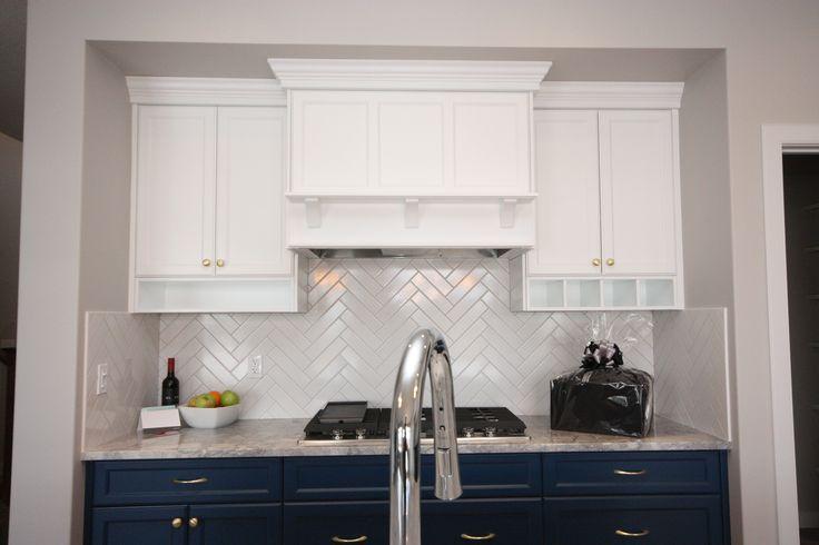 Custom cabinets, wine storage, herringbone subway tile, chrome faucet, kitchen