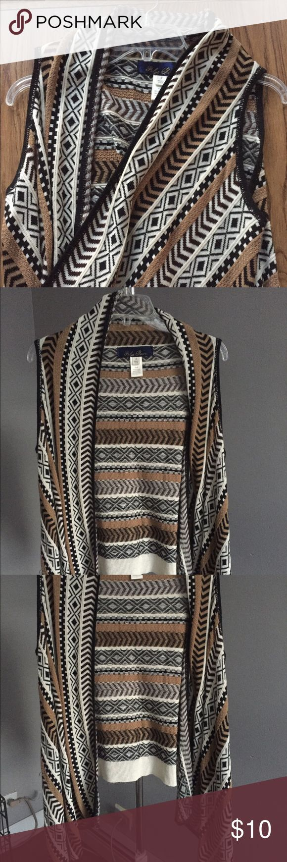 Tribal print sweater wrap Tribal print sweater wrap. Drape front with a shorter back. Lightweight and easy to use as a layering piece. Worn one time. Size small. Francesca's Collections Sweaters