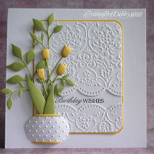 The vase is made with the Christmas bauble punch from stamping up just cut the top and bottom, then embossed with the Swiss Dots by Cuttlebug. The large set of leaves are Fresh Foliage and the Tulips are both from Memory Box.
