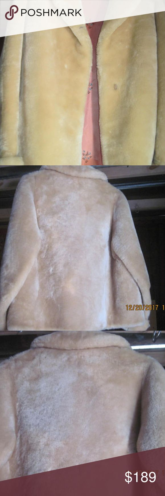 """Women's Short Vintage Beige Fur Coat, Size M Up for your consideration is a Women's Beige Short Length Fur Coat in a pre-owned, used, and vintage condition.  It features two front slip pockets, a pink floral patterned fabric interior lining, and folding sleeve cuffs.  There are holes, open seams, repairs, or missing clasp.  There is one front loop cord closure.  There is no manufacture tag or size tag. However,  the measurements reveal a size medium or a 14.  Length=26.5"""", Shoulders= 16""""…"""