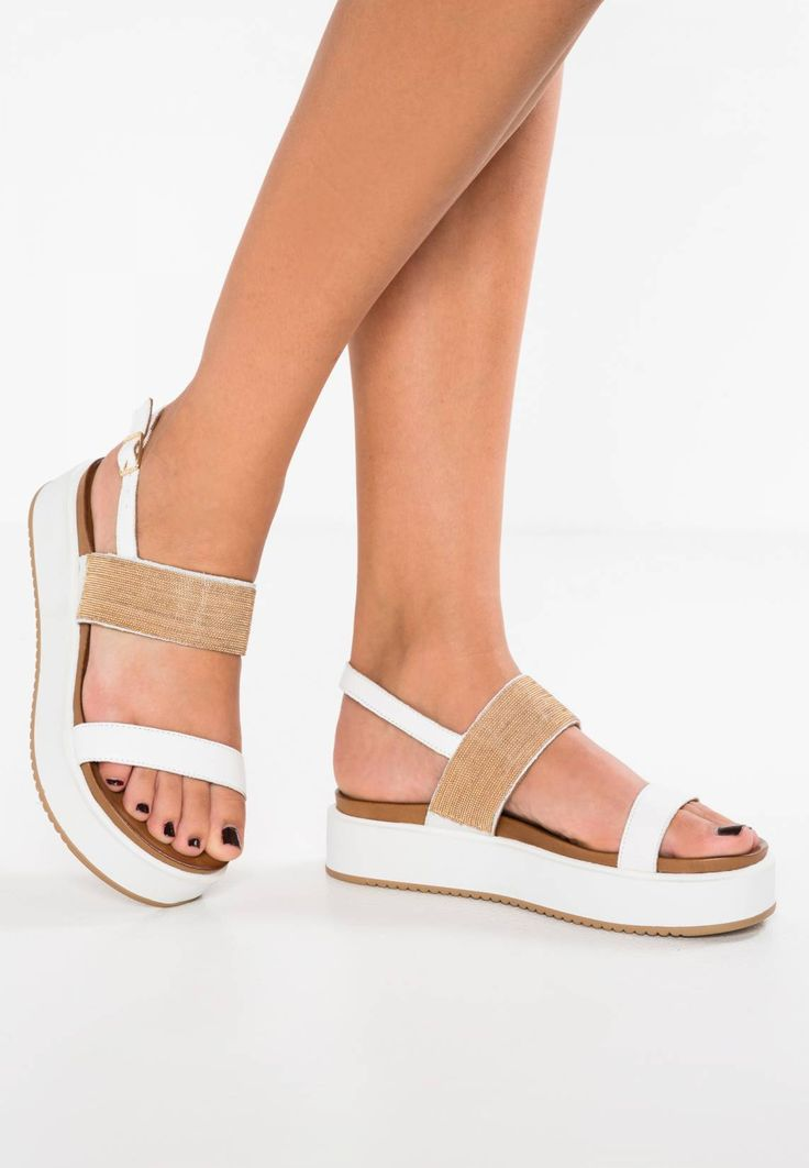 "Inuovo. Platform sandals - white. Sole:synthetics. heel height:1.5 "" (Size 4). Shoe tip:open. Padding type:Cold padding. Heel type:Platform boots. Lining:leather. detail:elasticated. shoe fastener:buckle/bow. upper material:leather..."