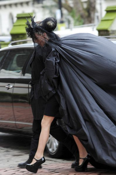 At St Paul's Church in Knightsbridge, London for the funeral of Alexander McQueen, February 2010.  DG wears Philip Treacy hat and McQueen cloak. i hope people dress like this at my funeral ..