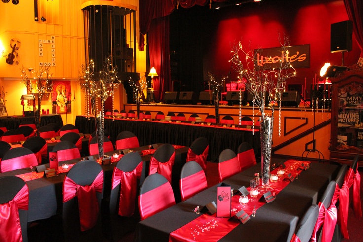 #wedding #weddingreception #black #red #sashes #satinsash #satinrunner #crystalscatters #diamontes #vases #fairylights
