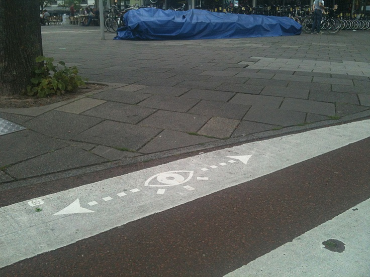 "Washing ""look right and left"" safety messages on the cross walks of Amsterdam"