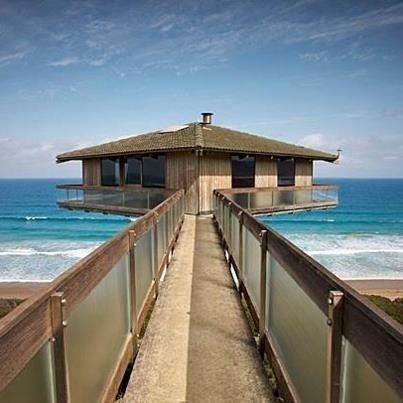 Really want to go to this pole house that almost sits over the road, great ocean road, australia