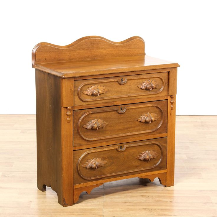 This eastlake style chest of drawers is featured in a solid wood with a gorgeous glossy cherry finish. This short dresser has 3 drawers, a curved top back and intricate carved acorn handles. Stunning antique sure to catch some attention!  #americantraditional #dressers #chestofdrawers #sandiegovintage #vintagefurniture