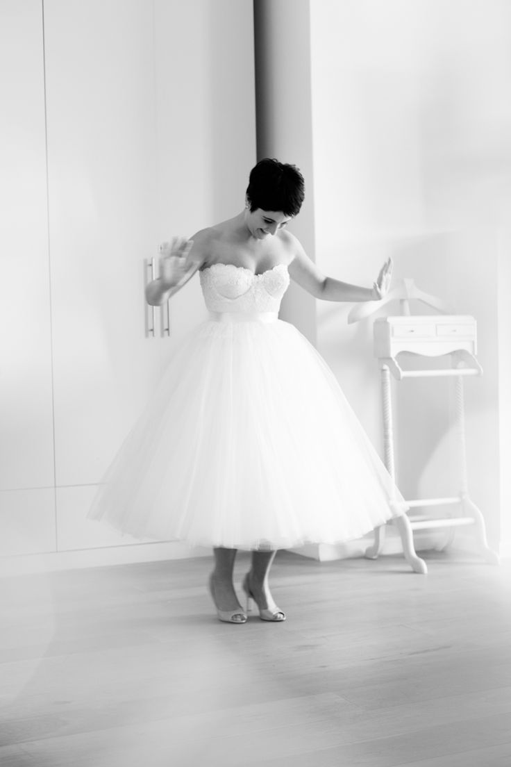 Bustier style dress with tea length tulle skirt by Janita Toerien. Photo by Yolande Marx