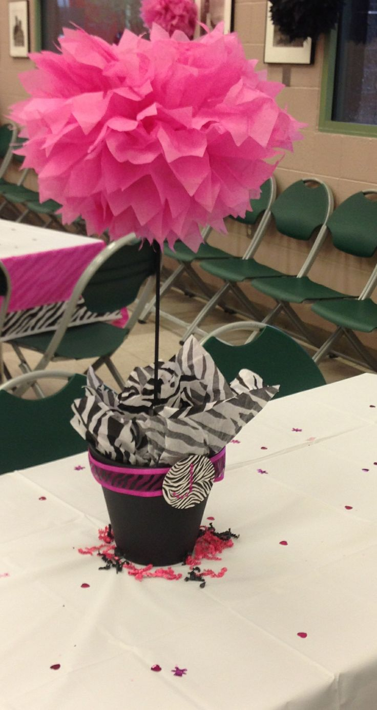 Centerpiece for pink and black zebra print theme baby shower.
