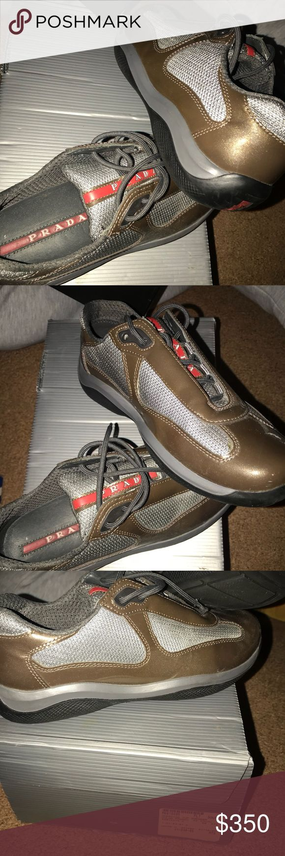 Prada sneakers Gold and grey AUTHENTIC Prada's. Price is negotiable but don't low ball. Sneakers are very comfortable. Very lightly worn. Bag and box included. Prada Shoes Sneakers