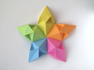 Origami: Stella aquilone - Kite Star. Modular origami, no cuts, no glue, 5 and 8 squares of paper, 9 cm x 9 cm. Designed and folded by Francesco Guarnieri, May 2012. CP of the module.