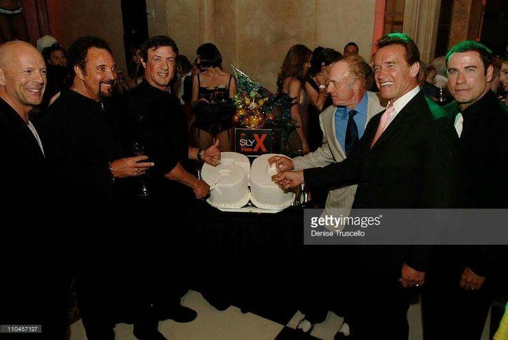 SIR TOM JONES WITH  (right) John Travolta, Arnold, James caan.Orlando,  Sylvester Stallone and Bruce Willis.