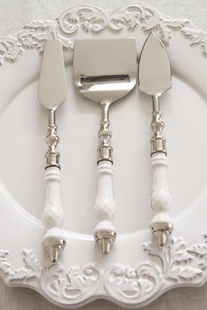 what beautiful serving pieces for cheese. love the design on the white platter.