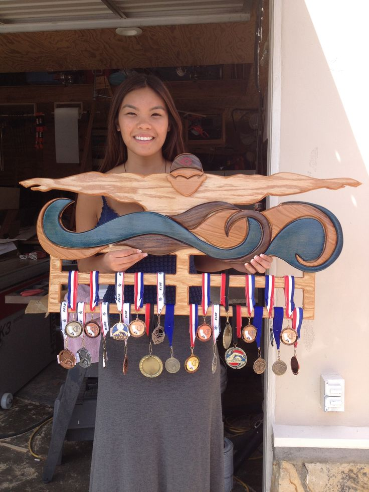 Home-made wooden medals rack for my swimmer boyfriend