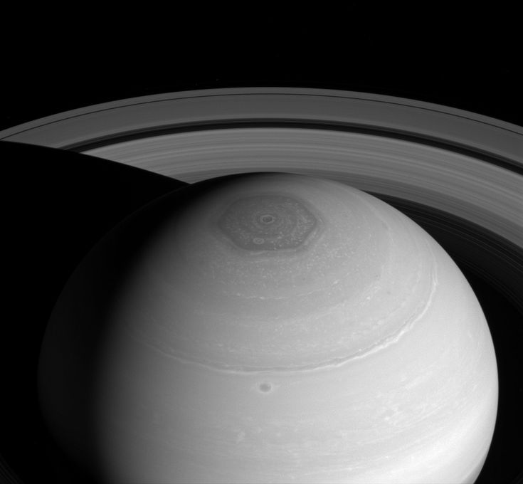 Saturn: North Polar Vortex/Hexagon/Rings The hexagon which is wider than 2 earths, owes its appearance to the jet stream that forms its perimeter. The jet stream forms a 6-lobed, stationary wave which wraps around the north polar regions at a latitude of roughly 77° North