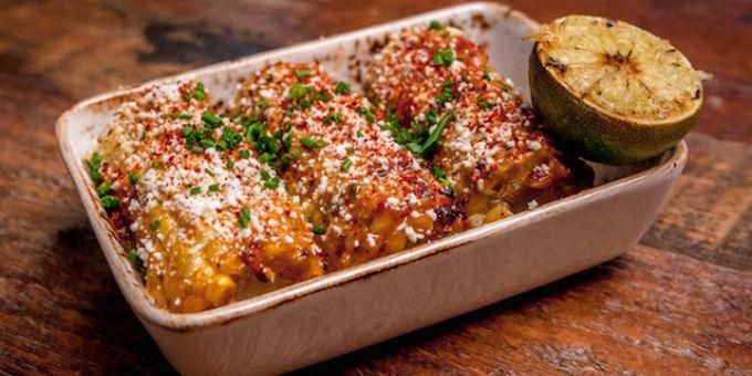Grilled corn with cheese and smoked paprika.