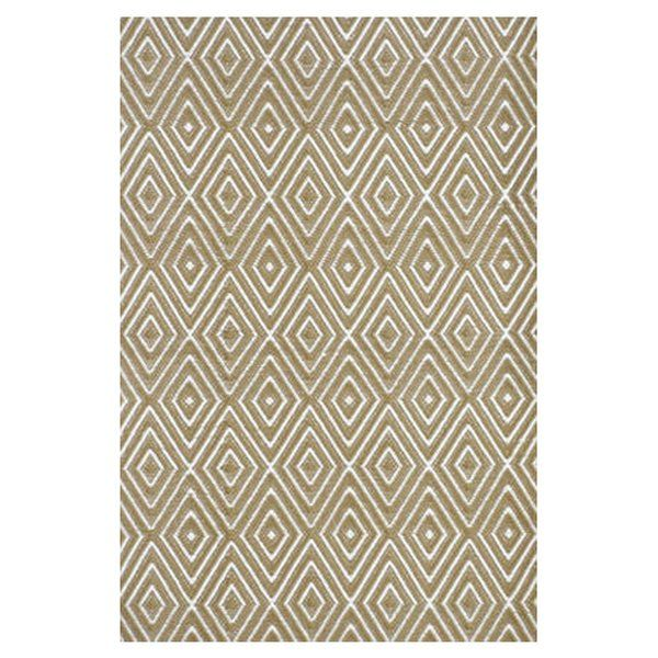 The Dash and Albert Rugs Woven Khaki Diamond Indoor/Outdoor Area Rug is constructed of 100% polypropylene making it sturdy and durable. It is hand woven and has a geometric pattern that makes it look alluring. This area rug features a stunning design in khaki, which allows it to blend well with all types of color schemes. This Woven Khaki Diamond Indoor/Outdoor Area Rug from Dash and Albert Rugs is fade, mildew, weather, and stain resistant. It is available in various sizes that yo...