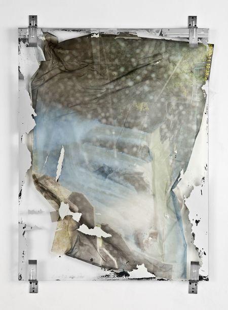 #ValerieSnobeck, Apparent #Structure, #2011  Partially erased mirror, peeled print on plastic, screen protector, debris netting, door barricade brackets   48 x 36 inches (121.9 x 91.4cm)   TDG-SNVA11.003