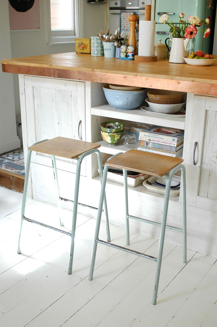 kitchen renovation tour — Patchwork Harmony. Vintage school science lab stools, kitchen island custom made from reclaimed wood, with copper trim, white painted floorboards.