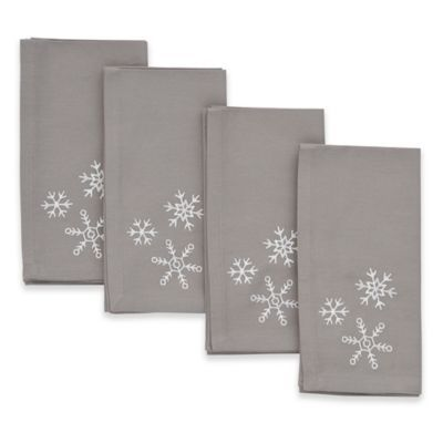 Make every dining experience special with the Embroidered Snowflake Napkins from ED Ellen DeGeneres. White snowflakes add an elegant touch to sophisticated grey cotton, designed to complement both casual and formal table settings, all season long.