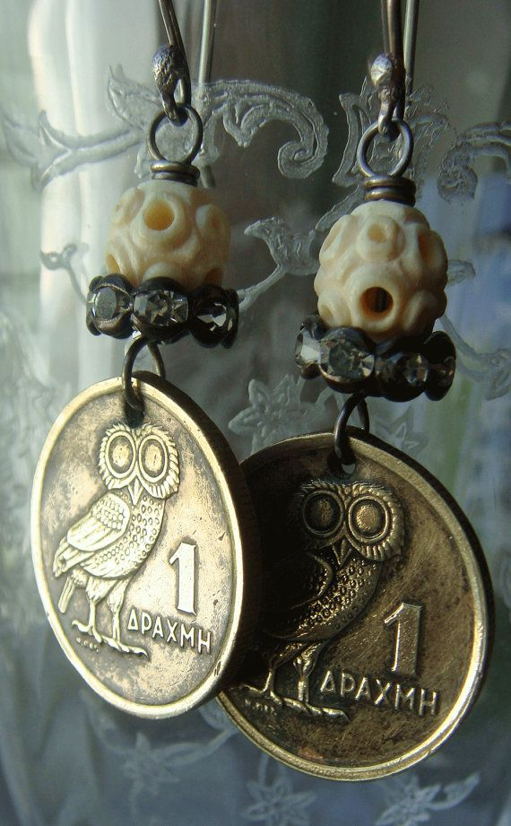 Vintage 1973 Greek drachma Athenian Owl motif coins have been repurposed into dangle earrings. Topped with rhinestones and vintage carved ox bone