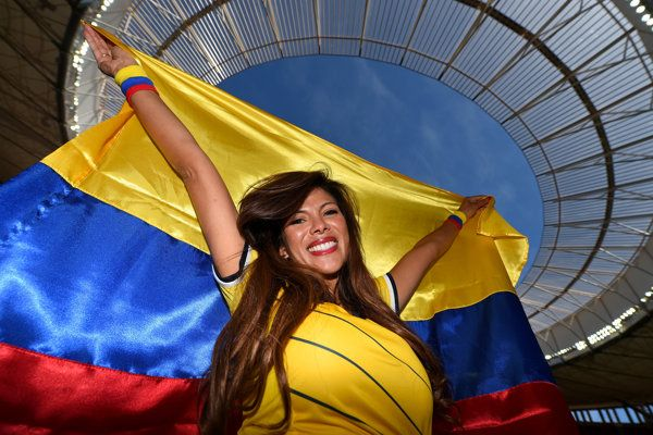 A Colombia fan poses prior to the 2014 FIFA World Cup Brazil Group C match between Colombia and Cote D'Ivoire at Estadio Nacional on June 19...